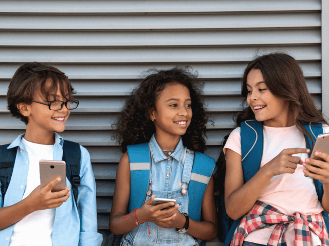 Three girls using their mobile devices